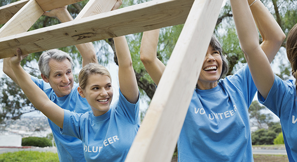 Volunteers lifting a frame