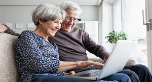 An older couple using a laptop
