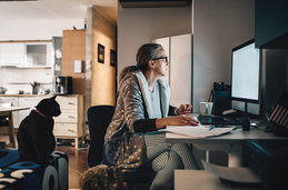 A woman working at home at her desk