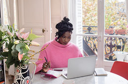 Photo of a woman with her laptop working at home