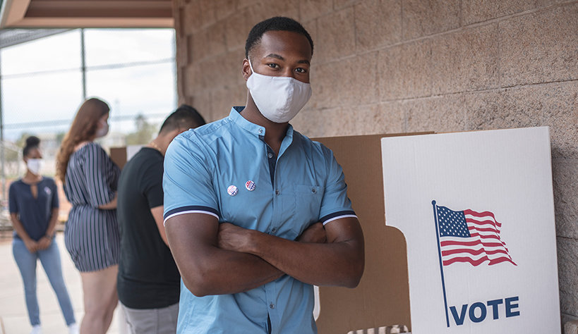 Photo of a man at a voting site