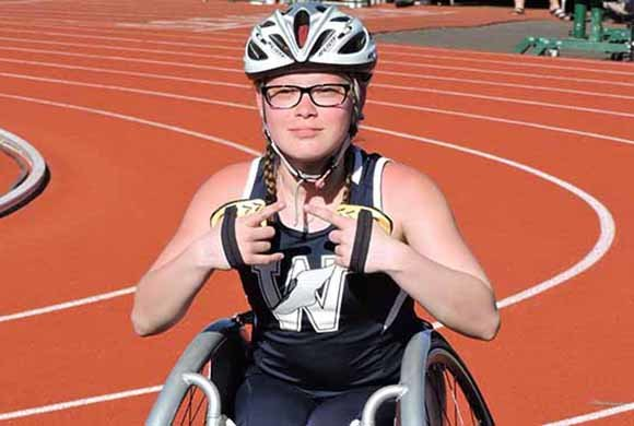 Photo of a girl in a wheelchair on a track