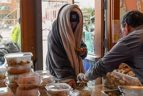 Photo of a man serving another man food