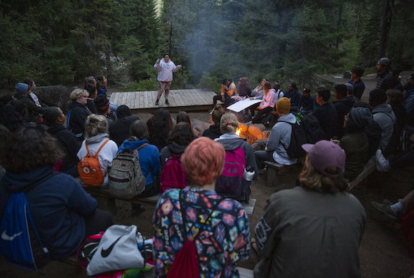 Photo of people at a campfire