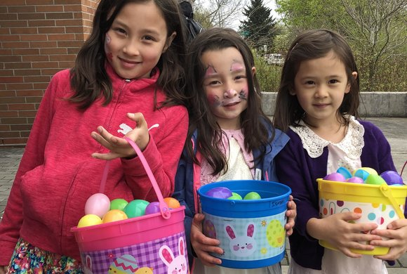 Photo of three girls at an egg hunt