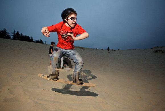 Photo of a boy sandboarding