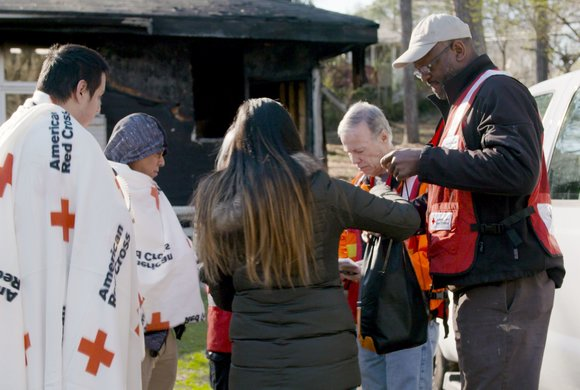 Photo of American Red Cross with people who've lost their home