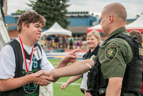 Photo of a young man meeting a sheriff
