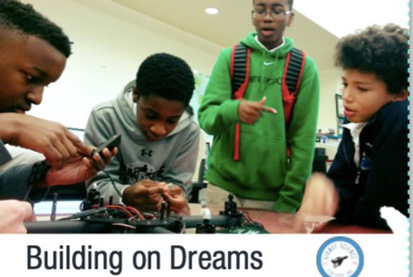 Building on Dreams - Photo of kids constructing a model