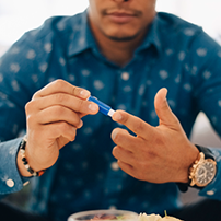 Photo of a man pricking his finger