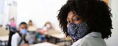 A teacher wearing a mask
