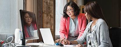 Two women reviewing benefits